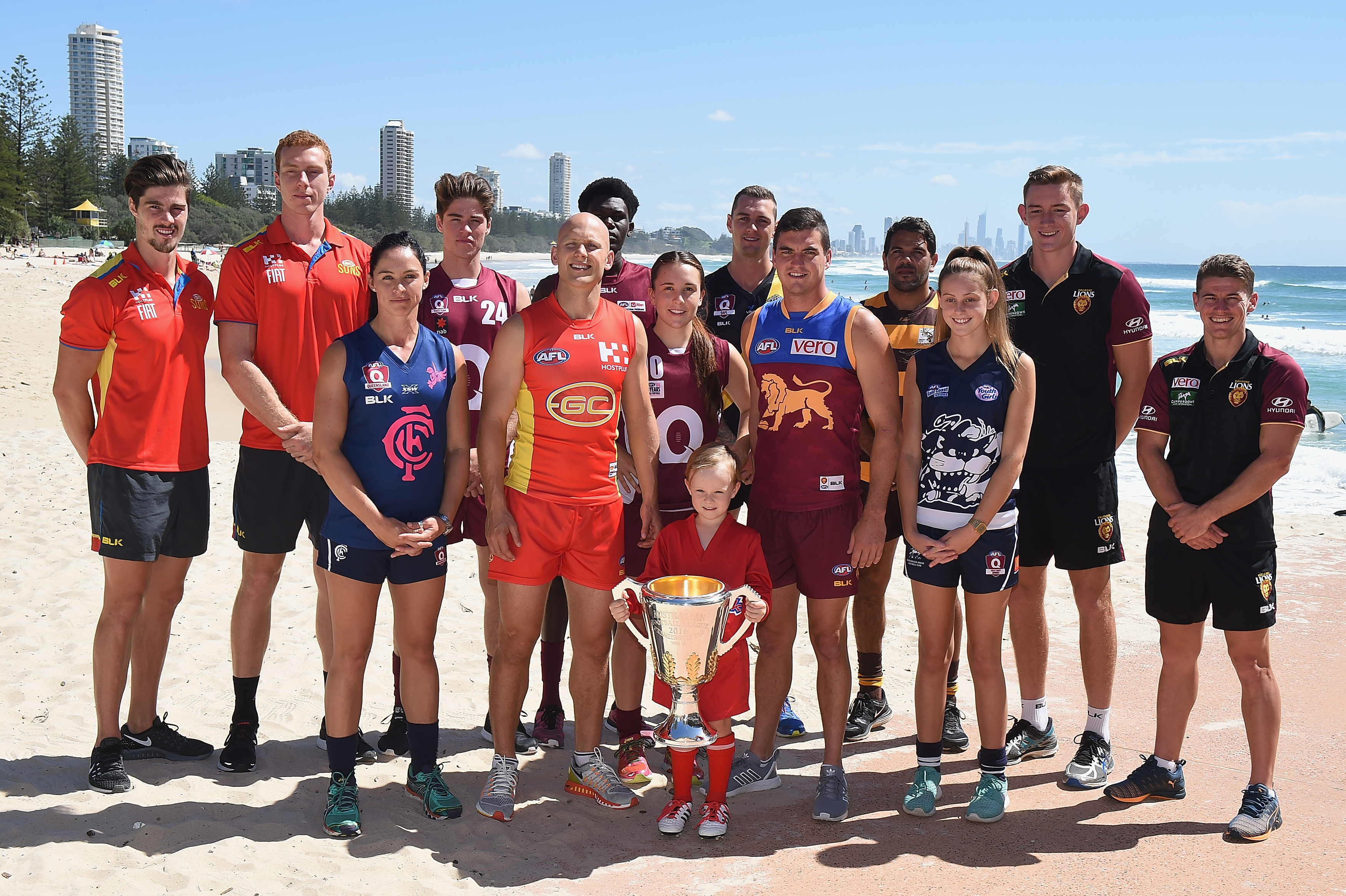 BURLEIGH HEADS, AUSTRALIA - MARCH 22: Gary Ablett and Tom Rockliff pose for a photo during the a press call to celebrates Queensland's 150 year anniversary of Australian Rules Football at Oskars on Burleigh in Burleigh Heads, Australia on March 22, 2016. (Photo by Matt Roberts/AFL Media)