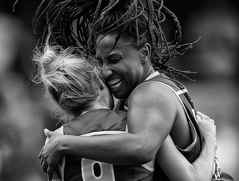 GOLD COAST, AUSTRALIA - MARCH 25: Sabrina Frederick-Traub (right) and Kate McCarthy of the Lions celebrate during the 2017 AFLW Grand Final match between the Brisbane Lions and the Adelaide Crows at Metricon Stadium on March 25, 2017 in Gold Coast, Australia. (Photo by Michael Willson/AFL Media)